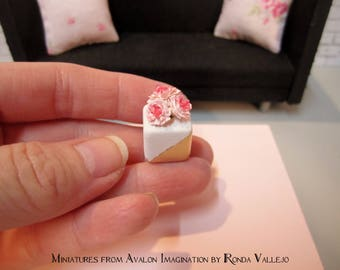Miniature dollhouse floral arrangement - pink and fuchsia flowers on a white ceramic cube vase dipped in Gold Metallic paint