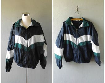 navy green windbreaker jacket | vintage 90s nylon track coat chevron pattern hipster hip hop clothing size m/medium athletic wear 1990s top