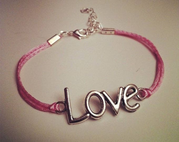 Pale pink cord bracelet with LOVE silver