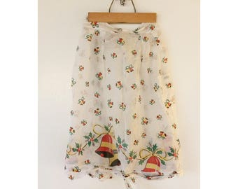 Sweet vintage Christmas apron with bells and holly. pockets.