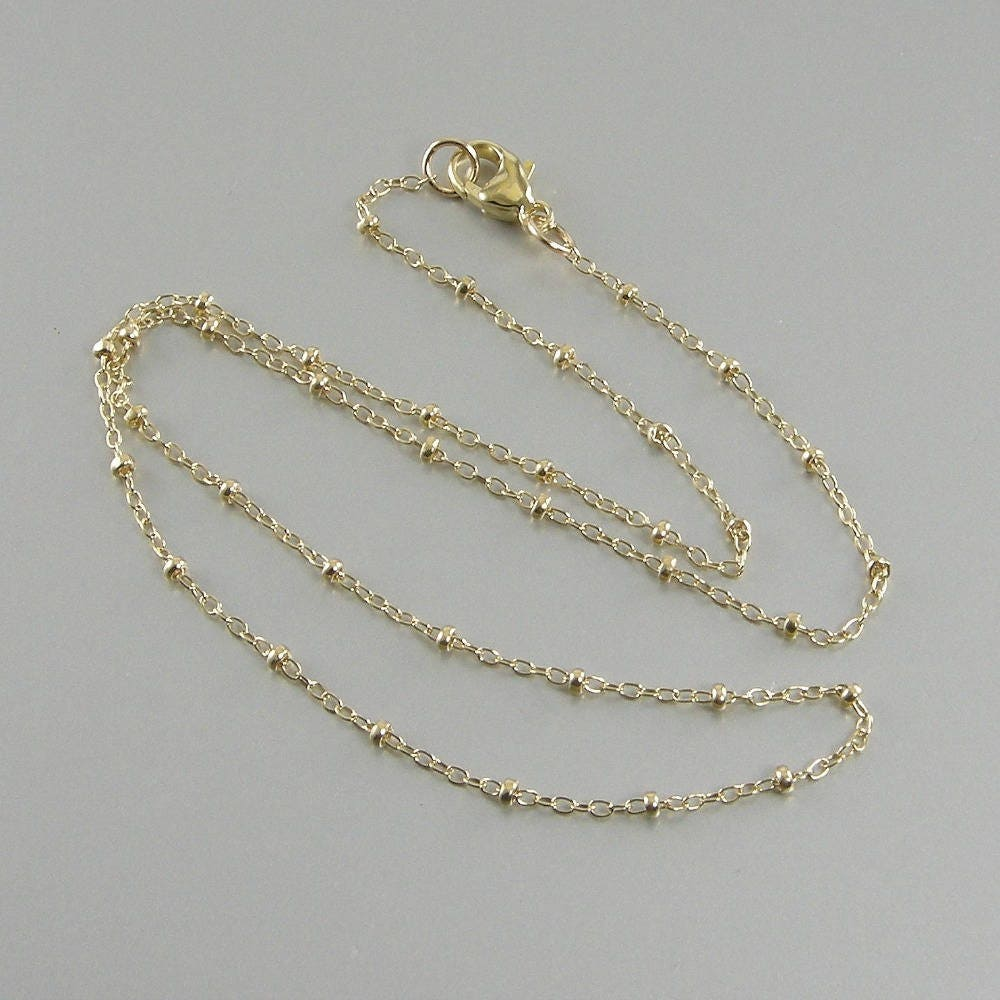 c s k j letter r necklace a catherine gold tiny initial h m popesco l t lv