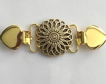 The mattie gold tone plastic flower waist shaper cinch clip