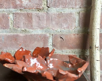 pair of vintage, handmade pottery dishes shaped like autumn leaves