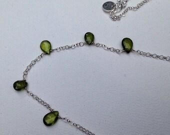 Five delicate drops of vesuvianite on a sterling silver chain necklace