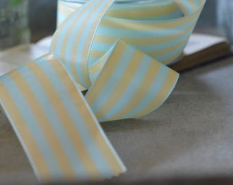 tan and light french blue striped ribbon