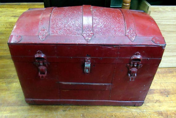 Antique humpback trunk painted red