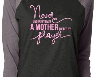 Never Underestimate A Mother Fueled By Prayer; Power of Prayer; Raglan Baseball Shirt; Mom Shirt; Praying Mom