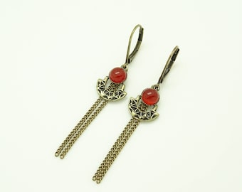 Earrings with charms and Red stone