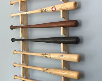 Horizontal display rack for 8 full sized baseball bats with trophy or ball shelf