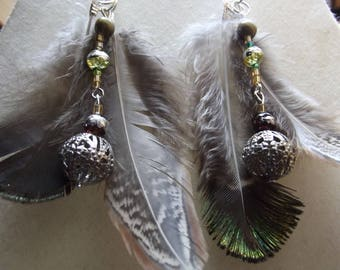 Earrings drilled peacock feathers and beads of 6cm high