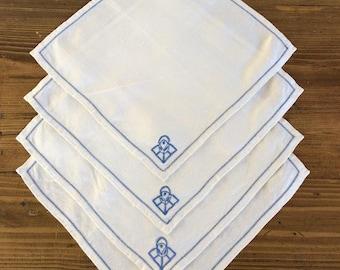 Vintage white napkins with blue stitching