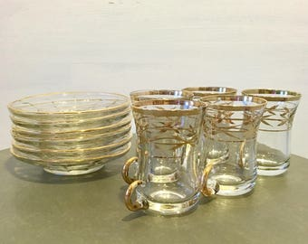 Set of five gold and glass espresso cups and six saucers / tea set