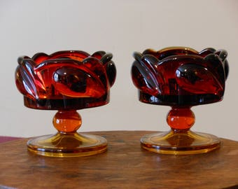 A Pair of Aubergine Glass Candle Holders