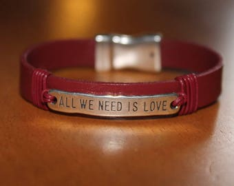 """red leather bracelet plate """"all we need is love"""" magnetic clasp"""