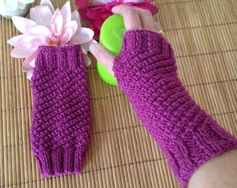 Mid-length pink fancy knit fingerless gloves