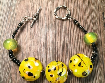 Handmade, 3 Yellow and Black lampwork beaded bracelet