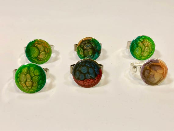 Enamel painted brass or silver-plated adjustable ring with abstract designs (multi-colors).