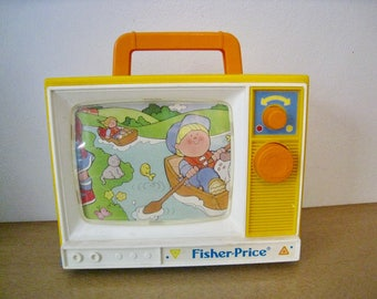 Fisher Price Two Tune Television Music Box. 1987 vintage toy. works. Plays London Bridge and Row Row Row Your Boat.
