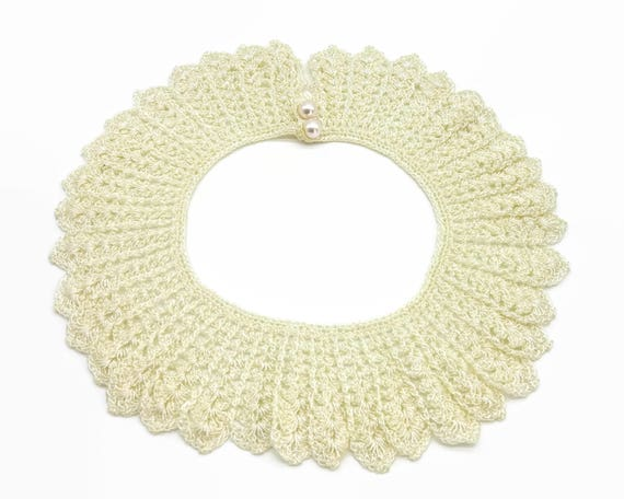 Mid century hand crocheted lace collar, ivory color with 2 pearl buttons, beautiful work, beautiful condition, suitable for dress or sweater