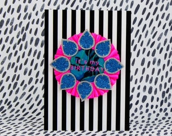 Neon pink and blue BIRTHDAY BADGE on a stripey A5 card. Handmade rosette printed with 'It's my Birthday'. Birthday card with badge.