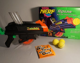 Nerf chainsaw etsy vintage 1994 nerf ripsaw blaster mib with unused order form and original nerf ballistic balls sciox Image collections