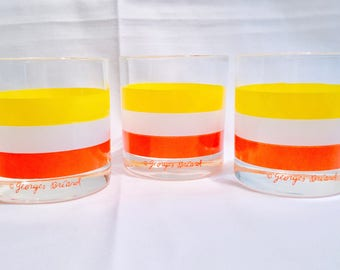 """Set of 3 Briard bright Striped Mid Century Modern Rocks, Old Fashioned glasses signed """"@Georges Briard""""  Yellow, White and Orange bands"""