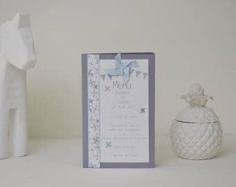 """Menu of table themed """"Windmill"""" pastel blue and gray with flags"""