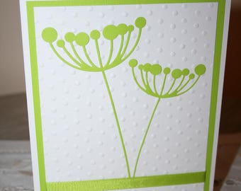 Green and white coloured card
