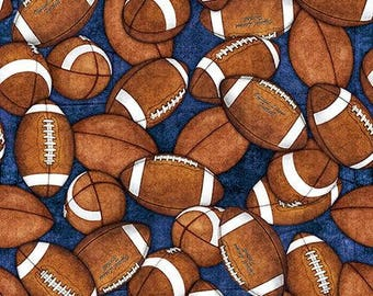Footballs on Blue Cotton Woven by Quilting Treasures