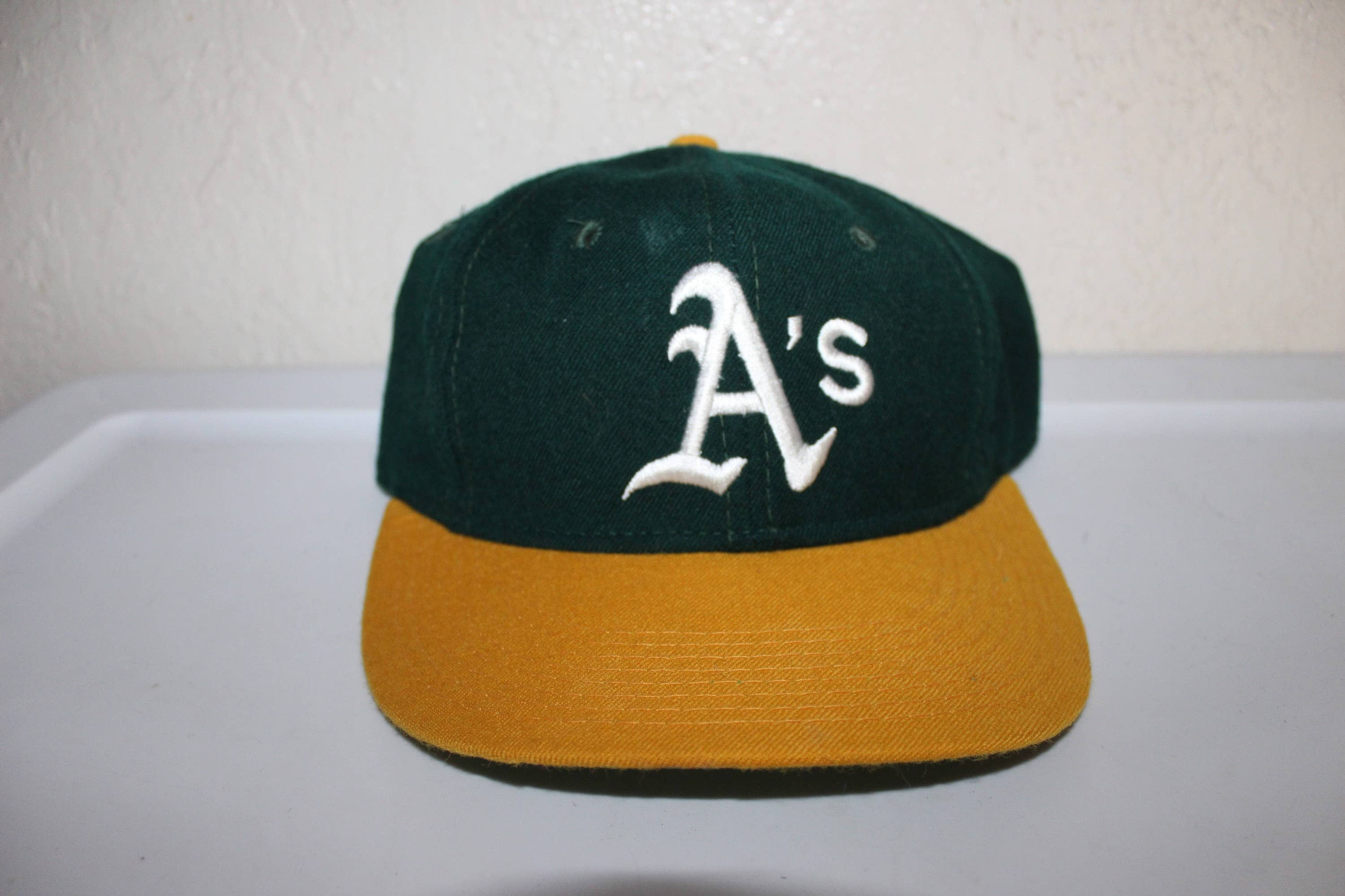 251eb964e24 ... top quality vintage 90s oakland athletics fitted baseball hat size 7 1  8 by new era ...