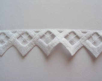 White embroidered lace triangular pattern
