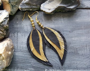 Gold black feather earrings. Statement earrings. Boho earrings. Bohemian earrings. Leather feather earrings. Long drop earrings. Boho chic.