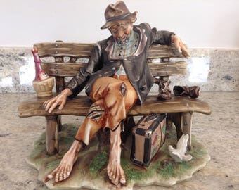 Capo di Monte vintage figurine of Old Tramp on a bench