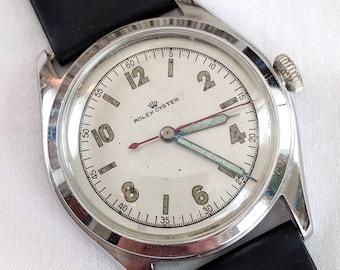 1945 Rolex Oyster wrist watch, mechanical wind, steel case, new leather strap, working