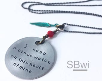 I keep a close watch on this heart of mine---necklace in  aluminum with coral and verdigris green detail