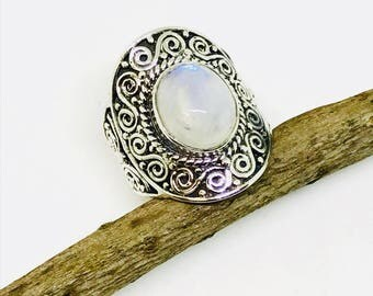 Rainbow Moonstone Ring set in sterling silver 92.5. Stone size- 10x12mm oval.Ring size -7. Natural authentic rainbow moonstone .