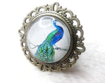 Round bronze Peacock ring is coughs