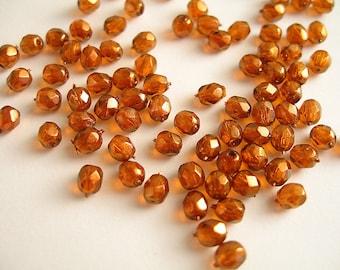 60 Czech glass faceted honey copper 4mm
