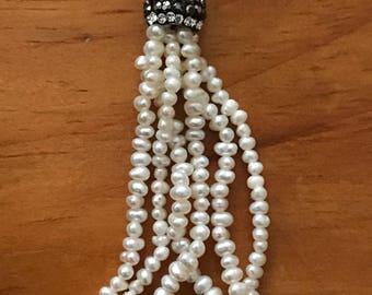 Pearl tassel
