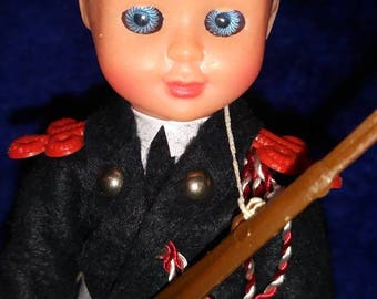 Military doll with open close eyes