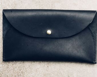 the west clutch in black // leather clutch with a single open pouch and snap closure