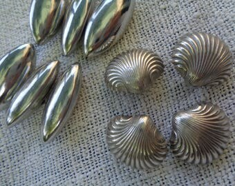 Little Collection of Vintage White Metal Buttons. 6 hollow polished tin toggles, 4 shells.