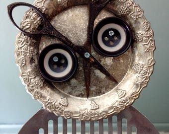 Owl Sitting on Branch.Found object art assemblage. Junk sculpture. Recycled, upcycled.
