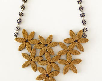 Gold flower necklace. Handmade with polymer clay, micro beads, and vintage elements.
