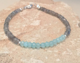 Beautiful blue and gray bracelet made with chalcedony and labradorite beads, Hill Tribe silver beads and a sterling silver trigger clasp