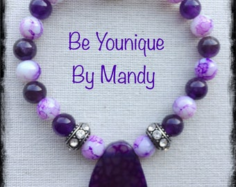 Purple beaded bracelet with purple glass pendant