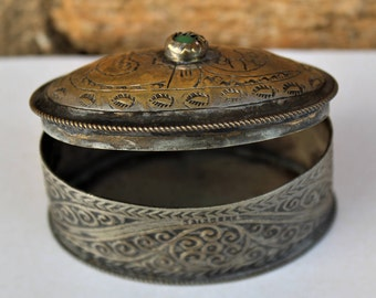 Embossed and engraved metal container possibly origionating from India
