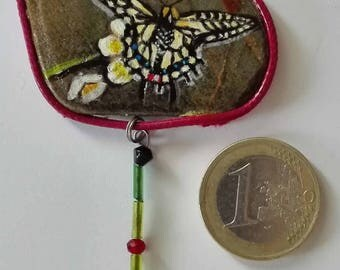 Hand painted natural stone pendant with an animal motif (butterfly) and floral, original and unique, artisan work. Vegan product.
