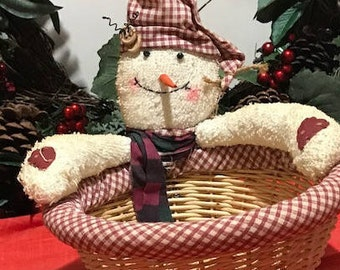 Cute Straw Basket with a Snow Man  on the edge.