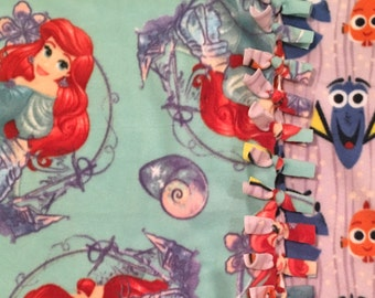 A Disney Princess Getting Fishy! The Little Mermaid handmade fleece throw blanket designed by JAX. A Disney Ariel Princess Theme Blanket!